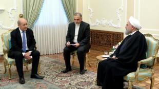 وزير الخارجية الفرنسي جان إيف لودريان مجتمعا بالرئيس الإيراني حسن روحاني.