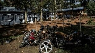 Motorbikes burnt during an attack outside an Ebola treatment centre in Butembo, the epicentre of the latest outbreak