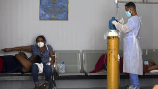 People receive medical attention in the COVID-19 ward of the Moscoso Puello Hospital in Santo Domingo