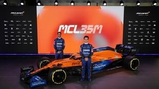 McLaren drivers Lando Norris (right) and Daniel Ricciardo show off the new McLaren Formula 1 car which will be powered by a Mercedes engine