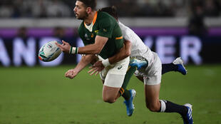 South Africa full-back Willie le Roux is tackled during the 2019 Rugby World Cup final against England in Japan