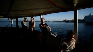 """It would be desirable if... an agreement is reached so that seven or eight countries coordinate to distribute the people,"" said Proactiva Open Arms founder Oscar Camps. Crew members are shown aboard the ship on World Refugee Day in June"