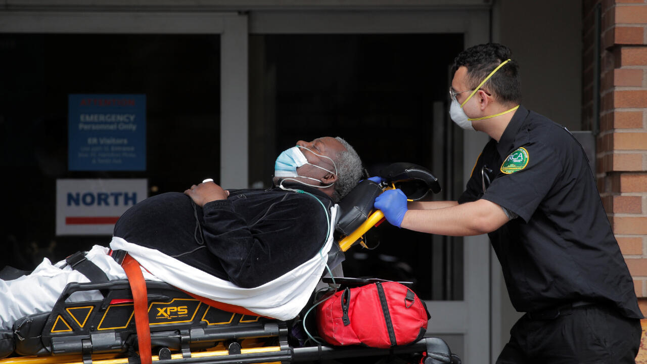Paramedics take a patient into emergency center at Maimonides Medical Center during the outbreak of the coronavirus disease (COVID-19) in the Brooklyn borough of New York City, New York, U.S., April 7, 2020.