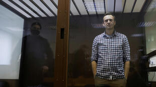 In this February 20, 2021 photo, Russian opposition politician Alexei Navalny attends a hearing to consider an appeal against an earlier court decision to change his suspended sentence to a real prison term in Moscow, Russia.