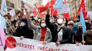 Students rally in Paris on January 26, 2021, urging the government to reopen university campuses and provide more financial support.
