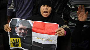 Archive picture of a pro-Morsi supporter protestinng the death sentences in January