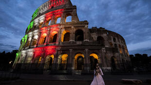 Rome's Colosseum lit up in the colours of the Italian flag.