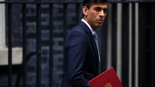 Britain's Chancellor of the Exchequer Rishi Sunak reacts as he leaves Downing Street, in London, UK, July 8, 2020.