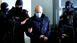 Balliet was brought handcuffed into the courtroom by armed guards