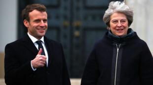 El presidente francés Emmanuel Macron y la primera ministra británica Theresa May durante la cumbre franco-británica en Sandhurst, cerca de Londres, el 18 de enero del 2018.