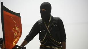 Un membre des Forces démocratiques syriennes au nord de Raqqa, le 6 juin 2017.