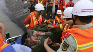 A rescue team prepares to look for more survivors from capsized passenger ship in the Yangtze river in China on June 2, 2015