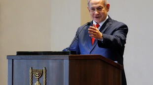Israeli Prime Minister Benjamin Netanyahu gestures as he speaks during a news conference at the State House in Entebbe, Uganda February 3, 2020.