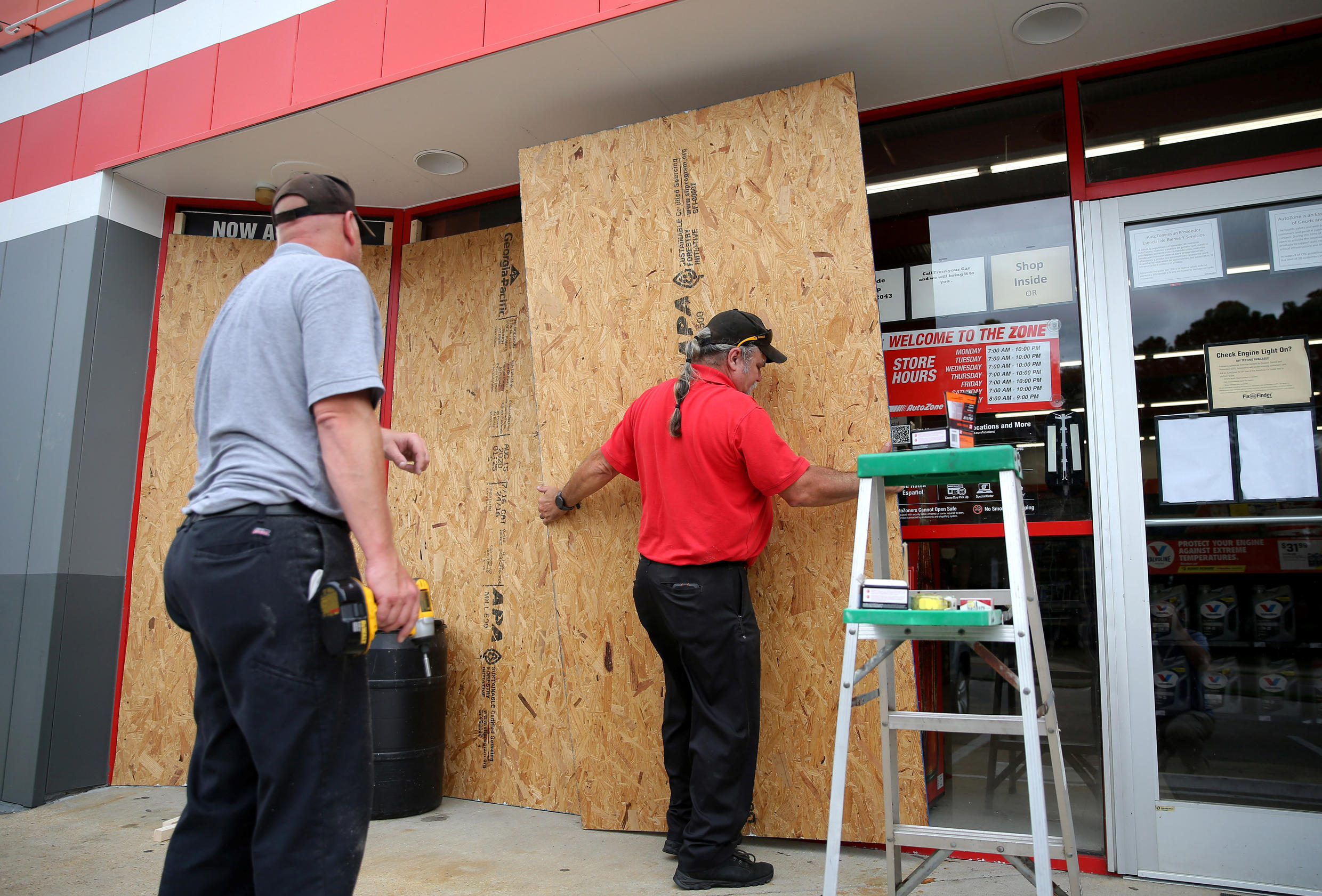Alex Vidmar, left, and Darrin Manning board up a business as Hurricane Sally approaches in Ocean Springs, Mississippi, U.S., September 14, 2020.