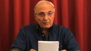 An image grab obtained from a handout video provided by the aide of former Egyptian premier Ahmed Shafiq on November 29, 2017, shows him speaking to the camera from the United Arab Emirates.