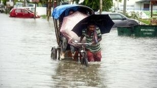 Torrential monsoon rains have brought floods and landslides to Nepal and northeast India