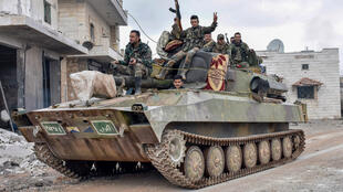 A handout picture released by the official Syrian Arab News Agency (SANA) on January 28, 2020, shows Syrian Army soldiers passing through the eastern outskirts of Maaret al-Numan in Syria's northernwestern province of Idlib.