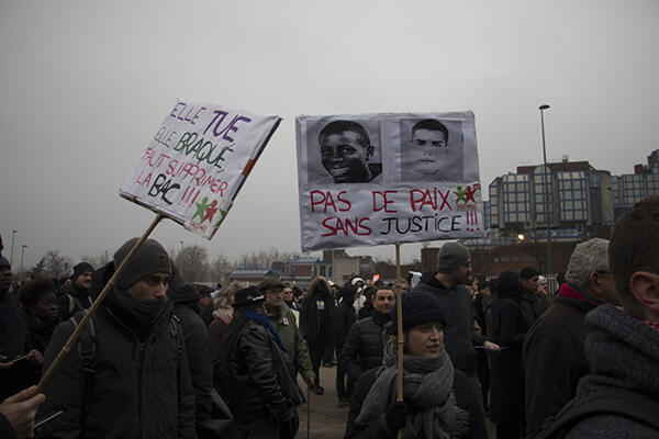 """""""No peace without justice,"""" reads this placard bearing the pictures of  teenagers Zyed Benna and Bouna Traore, whose death while hiding from police in 2005 triggered massive riots in suburbs across France."""