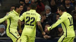 Barcelona's Luis Suarez (left) celebrates after scoring a double at the Etihad stadium.