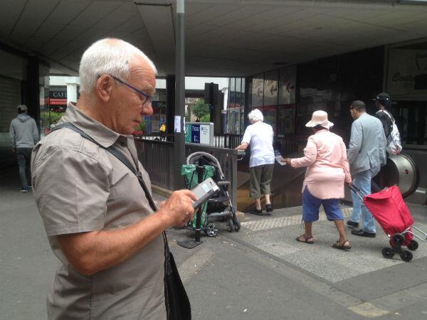 """Michel Moisan, retiree and volunteer """"greeter"""" in Saint-Denis."""
