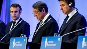 French President Emmanuel Macron (L) and Italian Prime Minister Giuseppe Conte listen as Cypriot President Nicos Anastasiades addresses a summit for southern EU countries in Nicosia on January 29, 2019
