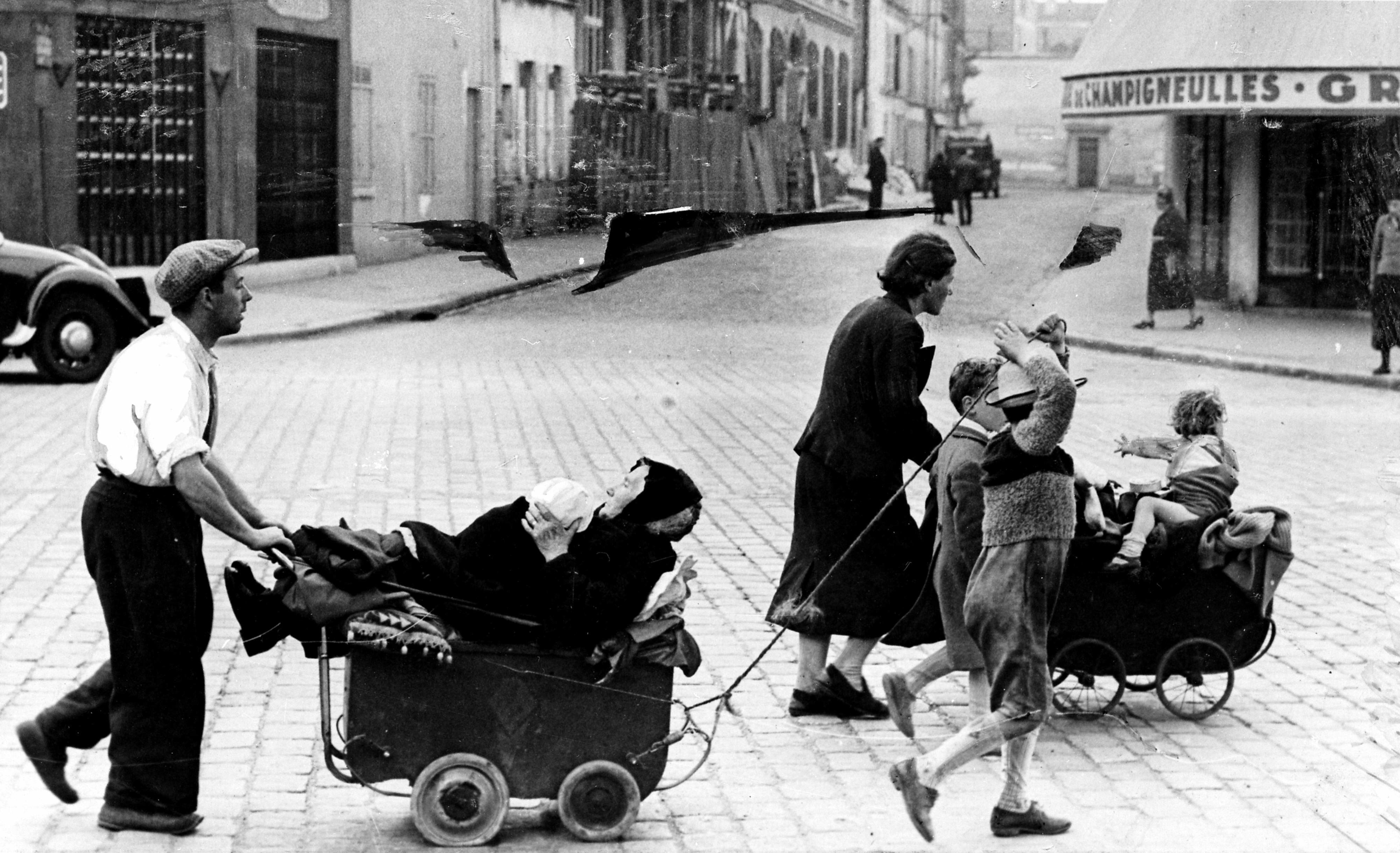 A family flees Paris in June 1940 with all their worldly goods.