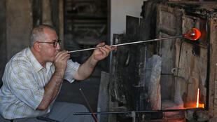 Mohamed al-Hallak and his brothers are the last family to keep up the tradition of glass-blowing in Syria's capital Damascus, according to a craft association