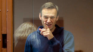 Russian opposition leader Alexei Navalny gestures during a hearing on his charges for defamation in the Babuskinsky District Court in Moscow on February 16, 2021.