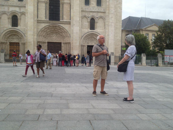 Moisan and Marylou, an American tourist from Delaware, in front of the Basilica of Saint-Denis.