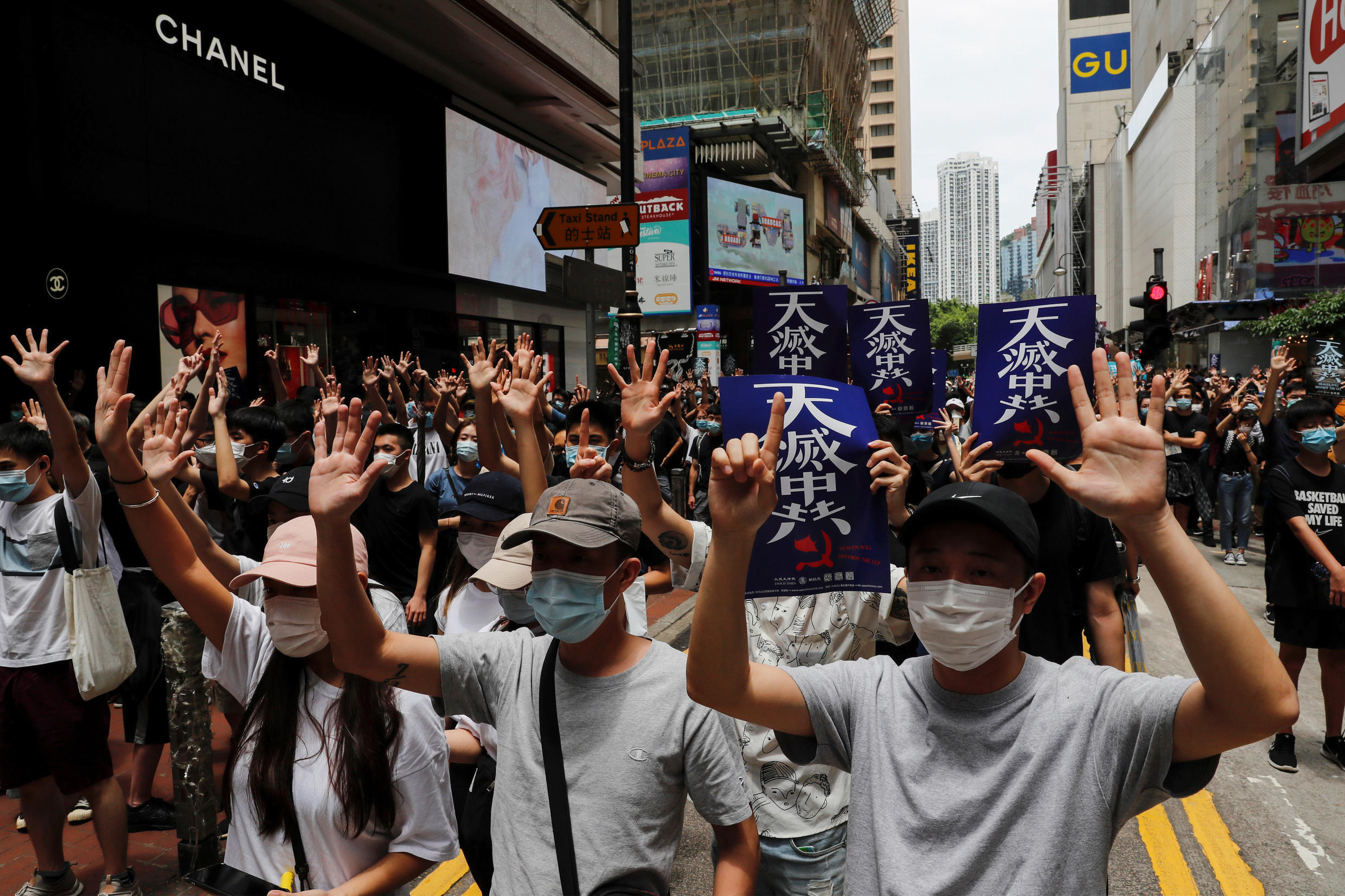 Anti-government protesters march again Beijing's plans to impose national security legislation in Hong Kong, May 24, 2020.
