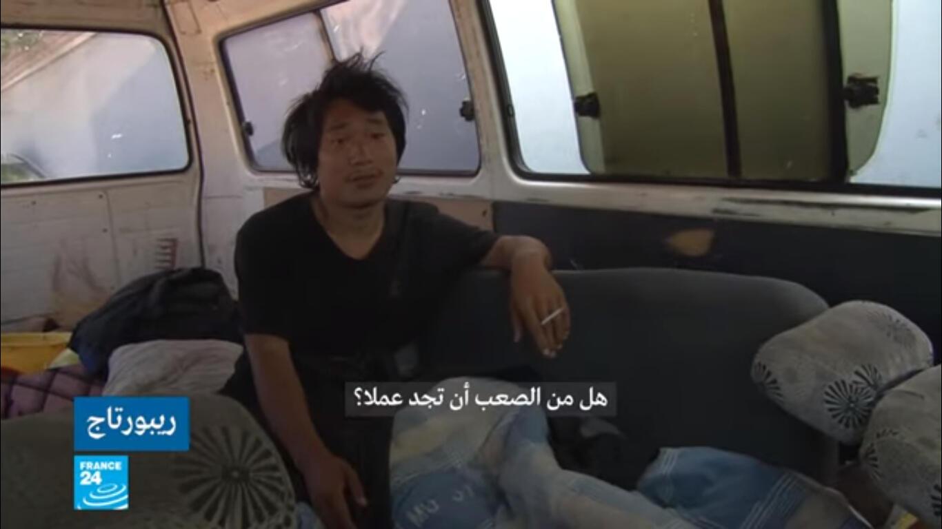 صورة ملتقطة من شاشة فرانس24 لأحد الباحثين عن العمل في الصين