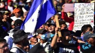 المهاجرون من أمريكا الوسطى يرغبون في الوصول إلى الولايات المتحدة قبل وصولهم إلى ولاية باجا كاليفورنيا، المكسيك في 25 نوفمبر/تشرين الثاني 2018.