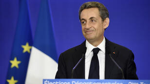 French UMP party leader Nicolas Sarkozy gives a speech following election results on March 29, 2015