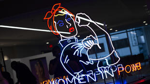 A neon sign depicting Rosie the Riveter is seen at The Wrap's Power Women Summit in Los Angeles on November 1, 2018.