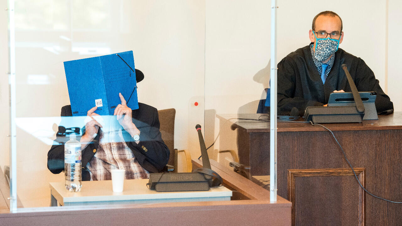 Hiding his face, Bruno Dey, 93, a former SS guard from Stutthof concentration camp, pictured in the courtroom of the regional court in Hamburg, Germany, July 17, 2020.