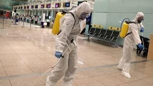 Members of the Military Emergency Unit (UME) disinfect the Josep Tarradellas Barcelona-El Prat Airport during a partial lockdown as part of a 15-day state of emergency to combat the coronavirus disease (COVID-19) outbreak in Barcelona, Spain March 19, 2020.