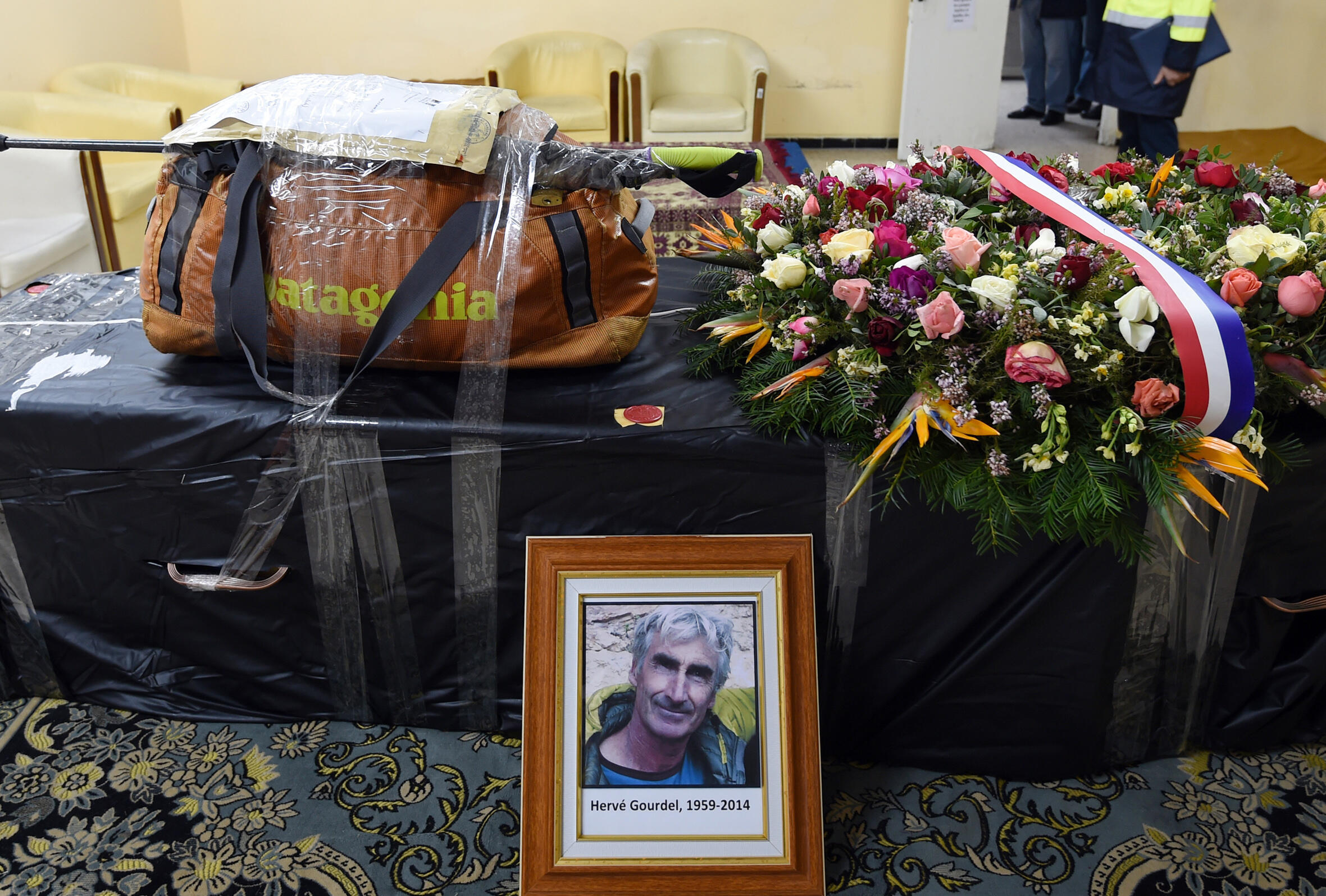 Gourdel's coffin, with the hiker's backpack and walking stick, pictured before being flown to Paris in January 2015.