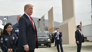 Mandel Ngan, AFP | US President Donald Trump (C) inspects border wall prototypes in San Diego, California on March 13, 2018.