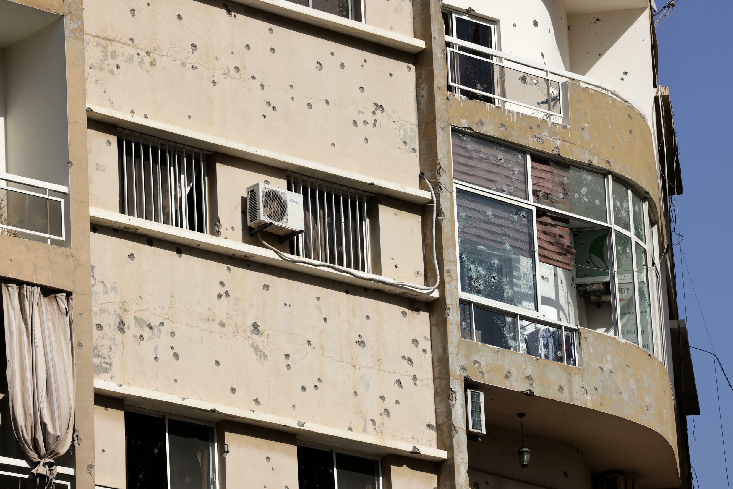 A bullet-riddled building during clashes in the Tayouneh area of Beirut, at the crossroads of Shiite and Christian militia bastions that were also battlegrounds in Lebanon's civil war