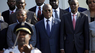 Haiti's new Prime Minister Joseph Jouthe (centre), standing alongisde President Jovenel Moise (right), is sworn in at a ceremony in the capital Port-au-Prince on March 4, 2020.