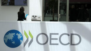 File photo of the OECD logo outside its headquarters in Paris.