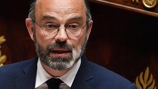 French Prime Minister Edouard Philippe  delivers a speech as he presents the government's plan to exit from the lockdown