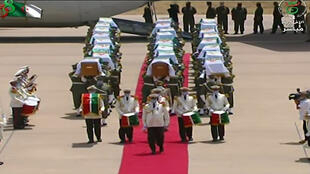 Algeria receives with full honours the skulls of 24 resistance fighters decapitated during French colonial rule that were held in storage in a Paris museum on July 3, 2020 in Algiers.