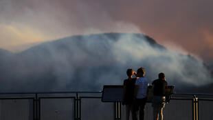 People watch as smoke from the Green Wattle Creek fire is seen from Echo Point lookout in Katoomba, New South Wales, Australia, December 6, 2019.