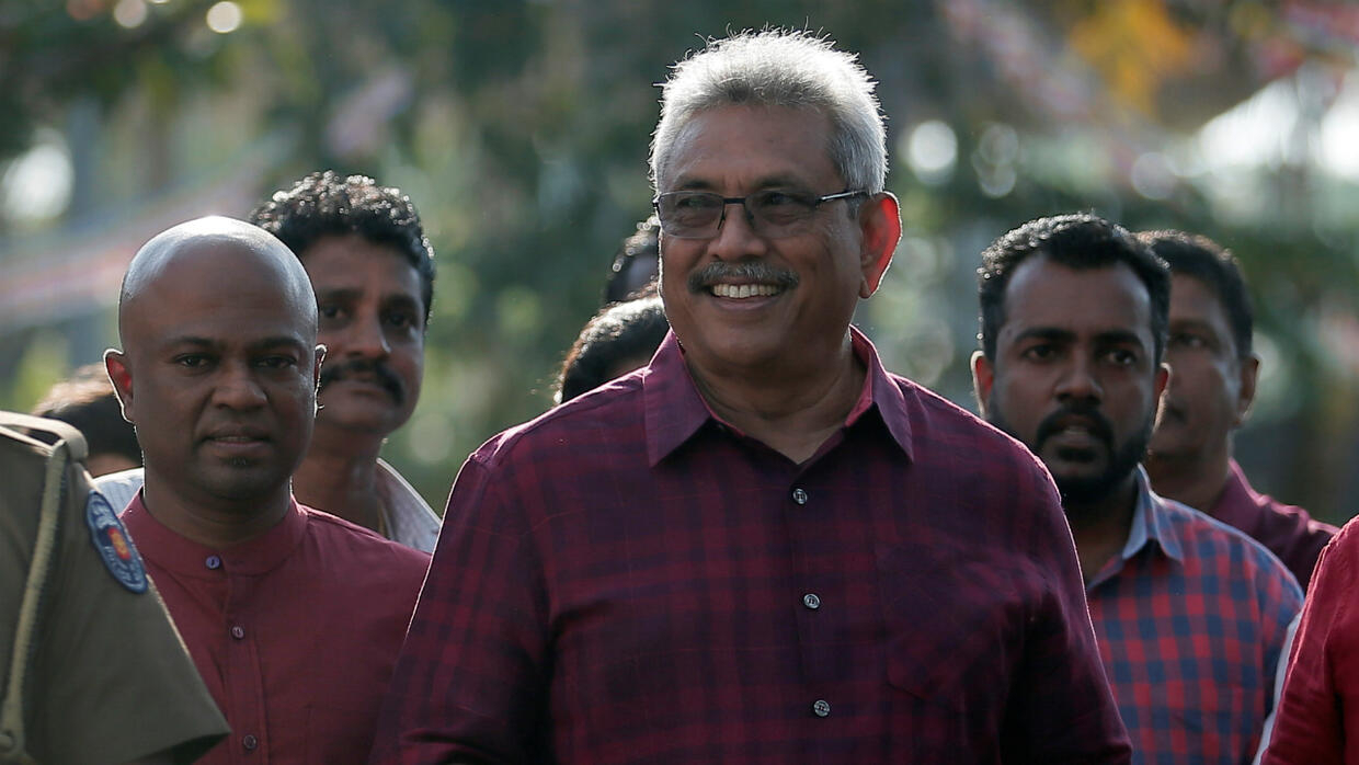 Former Sri Lankan defence chief Rajapaksa to become president after rival concedes electoral defeat