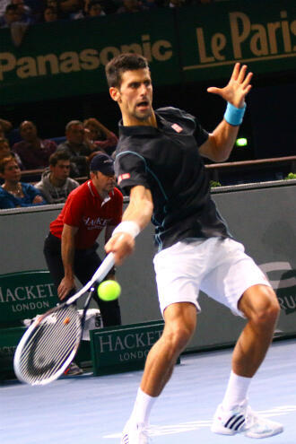 Novak Djokovic en plein échange face à David Ferrer