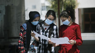 Palestinian school girls wear face masks due to the coronavirus pandemic in Gaza City, Gaza the impoverished enclave that has seen a spike in COVID-19 cases due to residents returning home from abroad