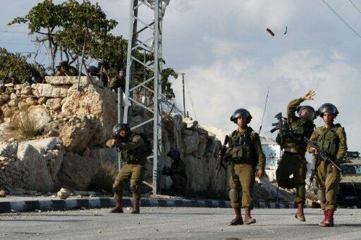 جنود إسرائيليون خلال مواجهات مع فلسطينيين في الضفة الغربية