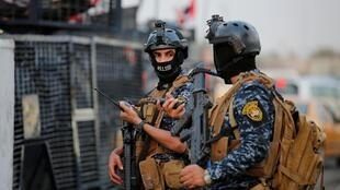 عنصران من الشرطة العراقية في بغداد في 7 أكتوبر/تشرين الأول 2019