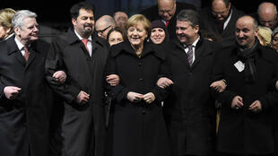 (L-R) German President Joachim Gauck, the chairman of the Central Council of Muslims in Germany Aiman Mazyek, German Chancellor Angela Merkel and German vice-chancellor Sigmar Gabriel at Tuesday's rally in Berlin